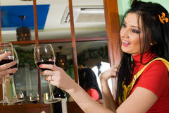 Girl with glass of red wine Stock Photos