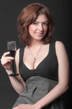 Girl with a glass of red wine Royalty Free Stock Image