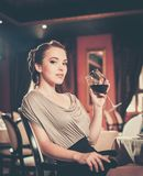 Girl with glass of red wine alone Stock Photo