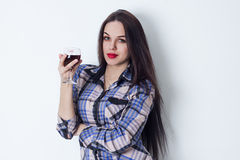 Girl with a glass of red wine Stock Images
