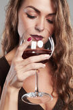 Girl with glass of red wine.Beautiful blond woman drinking red wine Royalty Free Stock Photos