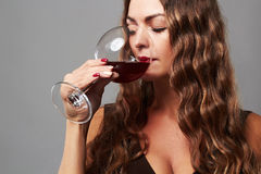 Girl with glass of red wine.Beautiful blond woman drinking red wine Stock Photo