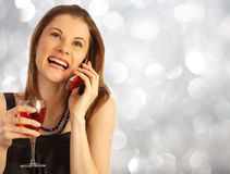 Girl with a glass of rose wine Stock Photos
