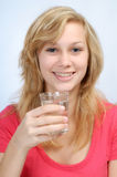 Girl with a glass of water Stock Photos