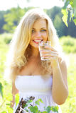 Girl with a glass of water in nature Royalty Free Stock Photos