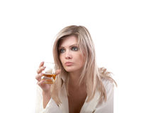 The girl with  glass of whisky Royalty Free Stock Photography