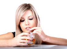 The girl with  glass of whisky Stock Images
