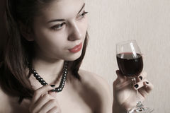 The girl with a glass of wine. Royalty Free Stock Photography