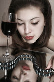 The girl with a glass of wine. Stock Image