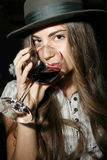 Girl with a glass of wine. Girl is tasting a red  wine Stock Images