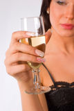Girl with glass of wine. Brunette girl with glass of wine on the white background Royalty Free Stock Photo
