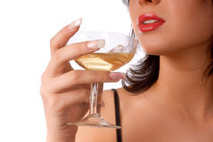 Girl with glass of wine. Close-up girl with red lips is holding glass of wine on the white background Royalty Free Stock Image