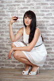 Girl with glass of wine Royalty Free Stock Photos