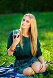 Girl on the grass with a glass of wine Royalty Free Stock Photography