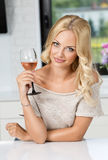 Girl with glass of wine posing Royalty Free Stock Photo