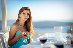 Girl with glass of wine Stock Images