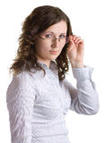 Girl in glasses. Young woman in glasses are looking seriously. Isolated on white background Royalty Free Stock Photography