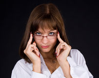 Girl in glasses. On a black background Royalty Free Stock Photo