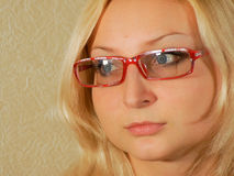 Girl with glasses. A serious look into the distance through the glasses Royalty Free Stock Image