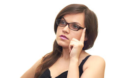 Girl in glasses. Beautiful girl in a black dress and glasses isolated on a white background Royalty Free Stock Image