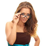 Girl in glasses. Beautiful girl in a brown dress and glasses isolated on a white background Stock Photo