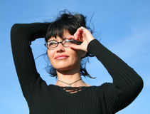 Girl with glasses. Brunette girl with glasses looking at distance stock photo