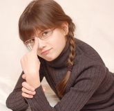 Girl in glasses. Portrait of serious looking girl in glasses Royalty Free Stock Images