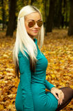 A girl with glasses in autumn Stock Images