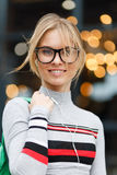 Girl in glasses on background of glass doors Stock Images