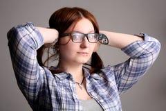 Girl in glasses. Beautiful girl in black glasses Stock Photos