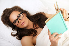 Girl in glasses with book royalty free stock images