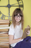 Girl in glasses with a book in hand. Royalty Free Stock Photos