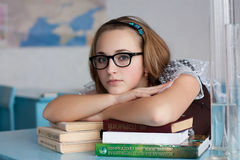 Girl with glasses with books Royalty Free Stock Photography