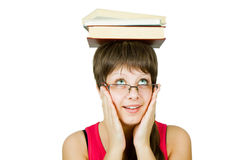 Girl in glasses with books on head Stock Photography