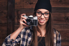 Girl in glasses and braces with vintage camera Stock Photos