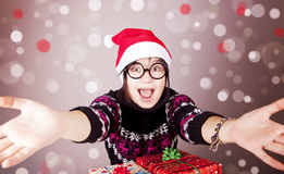 Girl in glasses with christmas gifts. Stock Photo