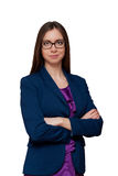 Girl in glasses crossed her arms. Girl business woman glasses crossed arms smiling glance confidence blue jacket Royalty Free Stock Photos