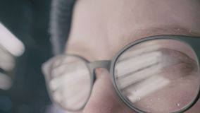 Girl with glasses eyes looking at the camera, extreme close-up with reflection stock video footage