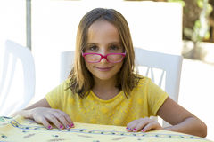 Girl with glasses falls Stock Photography