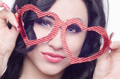 Girl with glasses in the form of heart Royalty Free Stock Photo