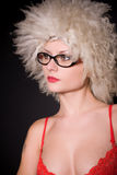 Girl in glasses and furry hat Stock Photo