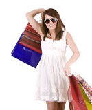 Girl in glasses with gift bag shopping. Royalty Free Stock Photo