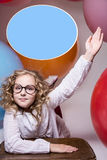 Girl in glasses with hand raised wants to ask Royalty Free Stock Photo