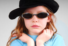 Girl in glasses and hat Stock Photo