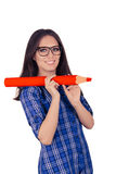 Girl with Glasses Holding Giant Red Pencil Royalty Free Stock Photography