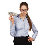 Girl with glasses holding a hundred dollar bill Royalty Free Stock Image