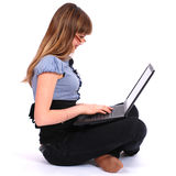 The girl in glasses holds laptop Stock Images