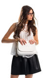 Girl in glasses holds purse. Stock Photography