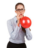 Girl inflating a red ball Royalty Free Stock Photos