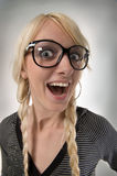 Girl with glasses looks like as nerdy girl, humor Royalty Free Stock Photography